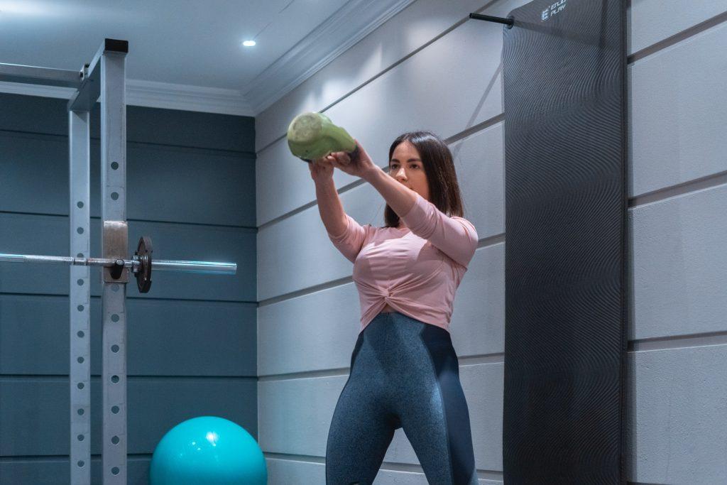 Woman using kettlebell